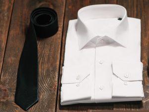 Svart slips på begravning Lavendla Begravningsbyrå